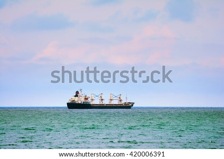 Ship Goes to the Open Sea - stock photo