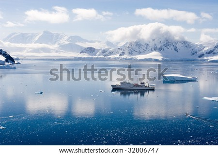 ship in an antarctic bay - stock photo