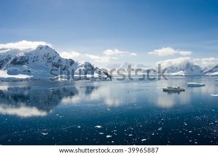 ship in an antarctic bay - stock photo