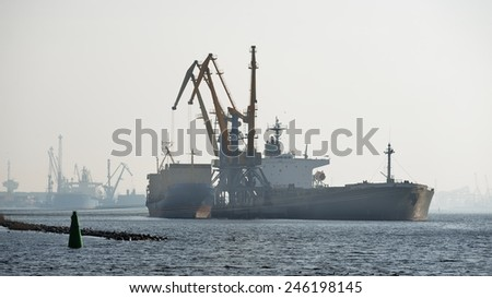Ship in cargo port coal terminal. Riga terminal, Latvia - stock photo