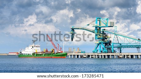 Ship in cargo port fuel terminal. Ventspils terminal, Latvia - stock photo
