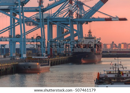 Ship in dock at sunset in the Port of Zeebrugge in Belgium. The port is a large container, bulk cargo, new vehicle and passenger ferry terminal handling over 50 million tonnes of cargo annually.