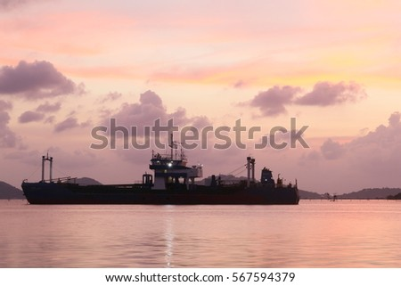 ship in lake with beautiful landscape on sunset