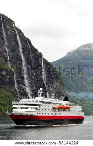 Ship in norwegian fjord. - stock photo
