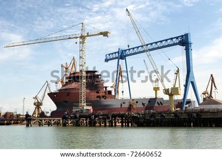 Ship In Repair Yard. - stock photo