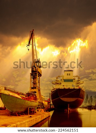 Ship in the port of dramatic scenery. - stock photo
