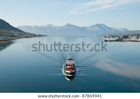 Ship in Tromsö, Norway, with panorama view to mountains in the background - stock photo