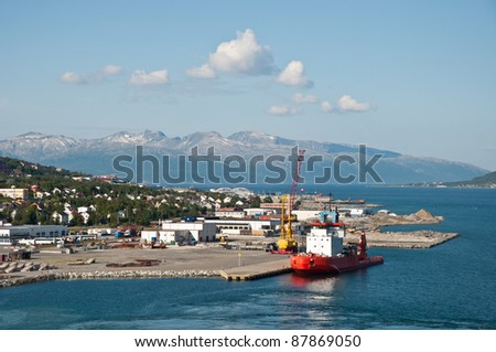 Ship in Tromsö¶, Norway, with panorama view to mountains in the background - stock photo
