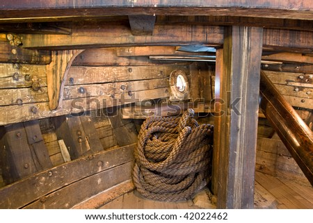 Ship interior with a coil of thick rope - stock photo