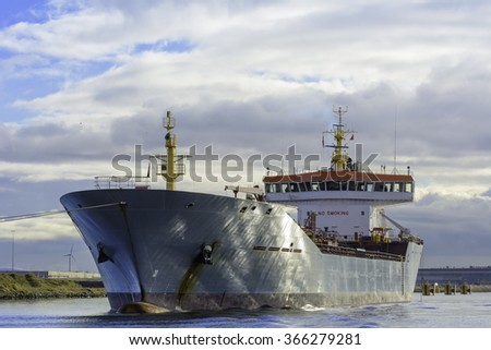 Ship is moored in the port of Amsterdam. The tanker is waiting to be shifted for cargo operations at the Oil terminal. - stock photo