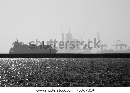 ship leaves industrial harbour of Rotterdam - stock photo