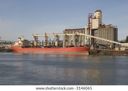 ship loading grain for export - stock photo