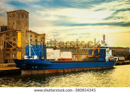 Ship loading grain in Port of Gdansk, Poland. - stock photo
