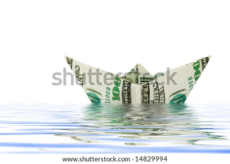 Ship made of money in water, isolated on white background - stock photo