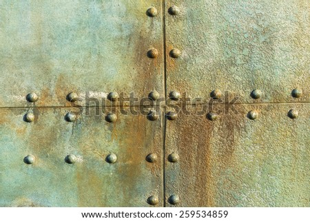 Ship Metal Plate Rivets  Old ship deck metal plate rivets detail background decor of era in ocean transport. - stock photo