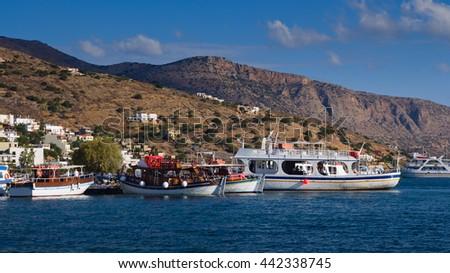 Ship moored off the coast of Elounda. Mirabello Bay. Crete, Greece - stock photo