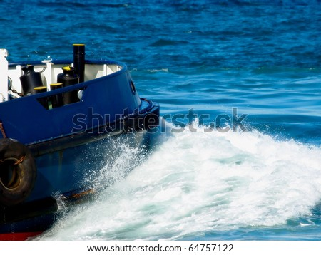 ship moving in the sea splashing water breaking the waves - stock photo
