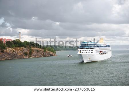 Ship near Sweden shore - stock photo