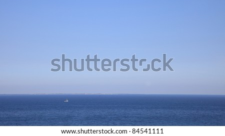Ship on clear sea surface
