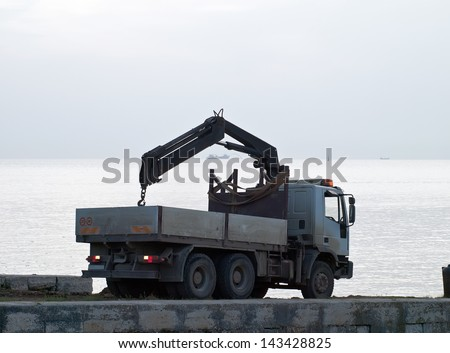 Ship on sea trial in cloudy afternoon - the truck is going back - stock photo