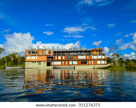 Ship on the Amazon river - stock photo