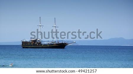 Ship on the beautiful blue sea. Greece. - stock photo