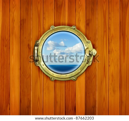 Ship porthole window with seascape ocean. Brass porthole at the old sailing vessel. - stock photo
