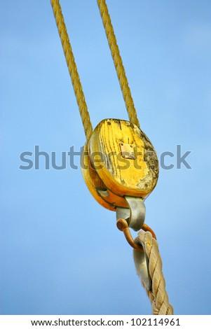 Ship rigging on blue sky - stock photo
