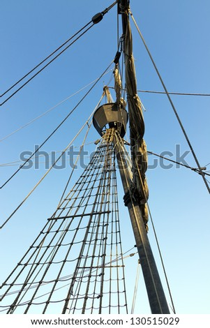 ship rigging on tall ship in front of sky background - stock photo