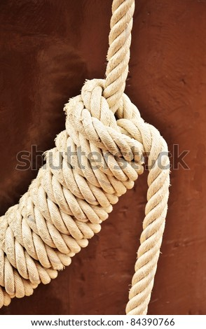 Ship rope was tied into a knot - stock photo