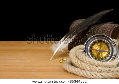 ship ropes and compass isolated on black background