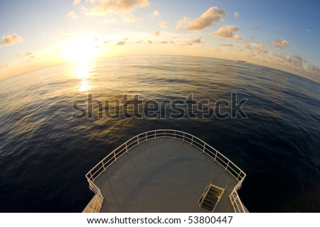 ship's bow in sunset time. wide angle view. - stock photo