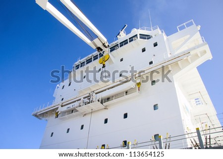Ship's superstructure with blue sky background.