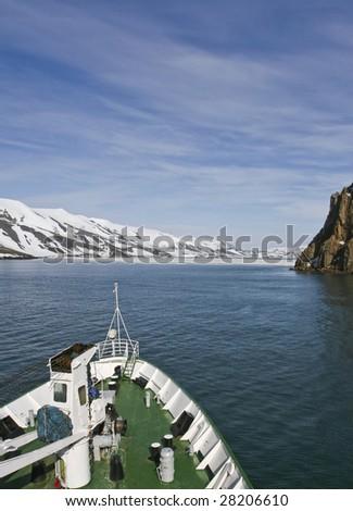 Ship sailing into Deception Island - stock photo
