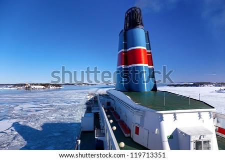 Ship sailing the frozen blocks - stock photo