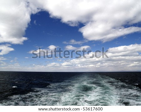 Ship trace at sunny cloudy day - stock photo