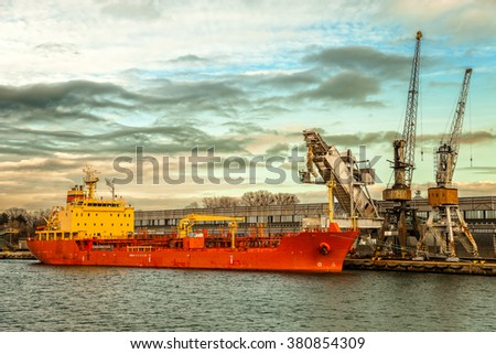 Ship under loading stone in Port of Gdansk, Poland. - stock photo