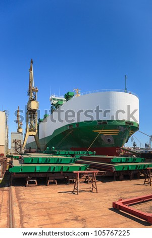 Ship vehicle carrier during the renovation of the shipyard in Gdansk, Poland. - stock photo