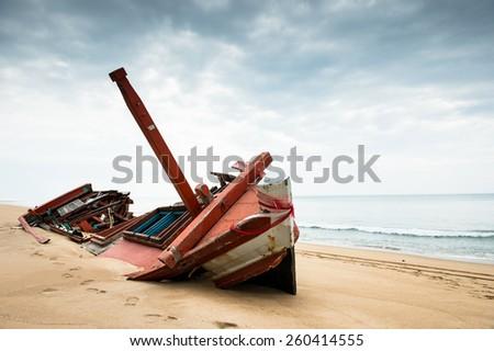 Ship wreck on beach - stock photo