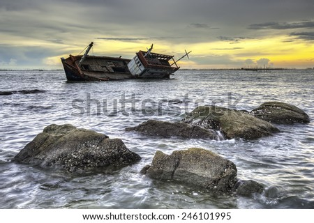 ship wrecked at sunset in Chonburi ,Thailand - stock photo