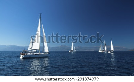 Ship yachts with white sails in the open Sea. Boats in sailing regatta. Sailing yacht race. - stock photo