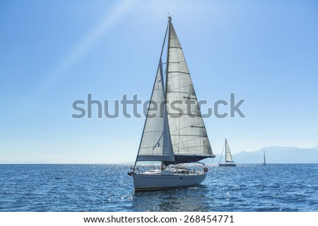 Ship yachts with white sails in the open Sea. Sailing. Luxury boats. - stock photo