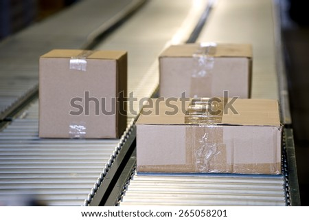 Shipping Boxes On A Conveyor Belt/ Shipping Merchandise - stock photo