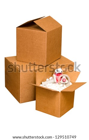 Shipping boxes with packing peanuts and tape dispenser isolated on white background with clipping path. - stock photo