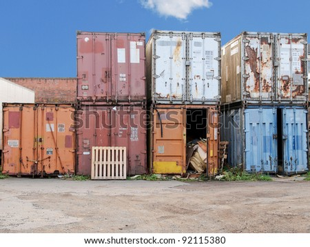 Shipping container used for cargo freight delivery by ship, aircraft, train, truck - stock photo