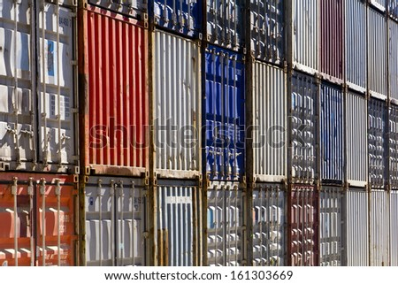Shipping containers; a wall of shipping containers  - stock photo
