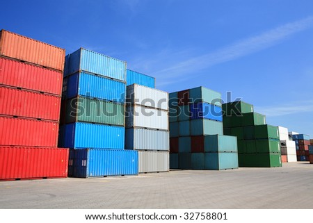shipping containers - many cargo freight containers stacked in harbor - stock photo