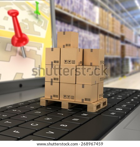 Shipping, delivery and logistics technology business industrial concept: macro view of heap of stacked corrugated cardboard package boxes on computer PC laptop notebook keyboard with selective focus - stock photo
