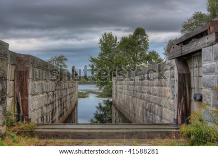 Shipping locks on an old canal - stock photo