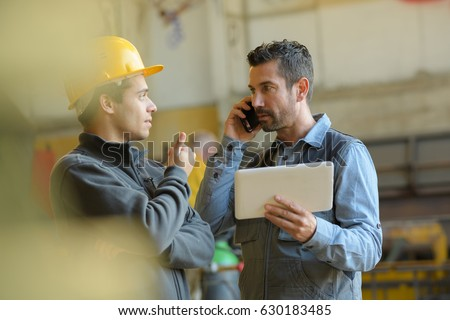 shipping manager and a worker
